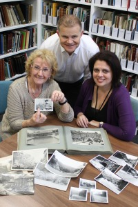 Phyllis Higton points to a photo of her late father, the photographer Harry Gill, before handing over his photographic collection to Lisa Langley-Fogg from the Local Studies Library and Nick Tomlinson from 'Picture the Past'.